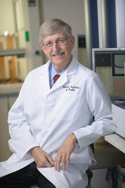 Francis COllins, director of the National Institutes of Health, is pictured sitting down in a white coat.