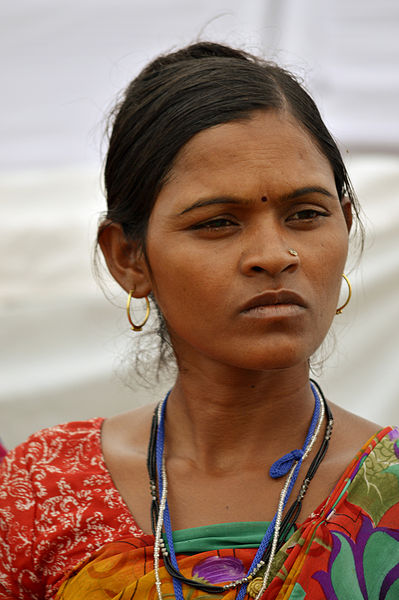 An Indian woman gazes into the distance and appears to be thinking.