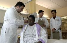 Doctor examining a black patient