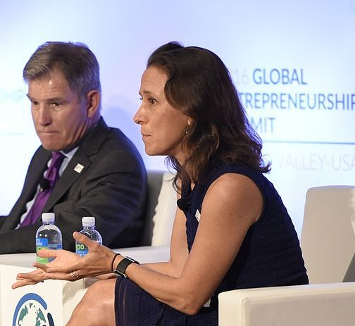 Anne Wojcicki appears engaged as a speaker on a panel.