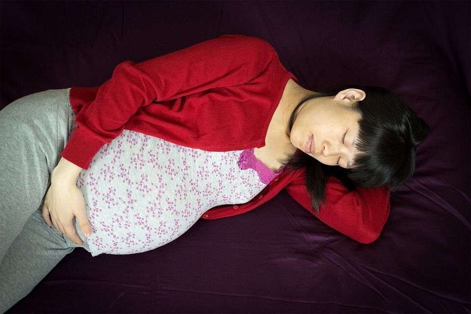Pregnant Chinese woman lying down