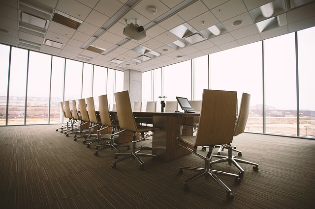 Beige conference room surrounded by glass windows.