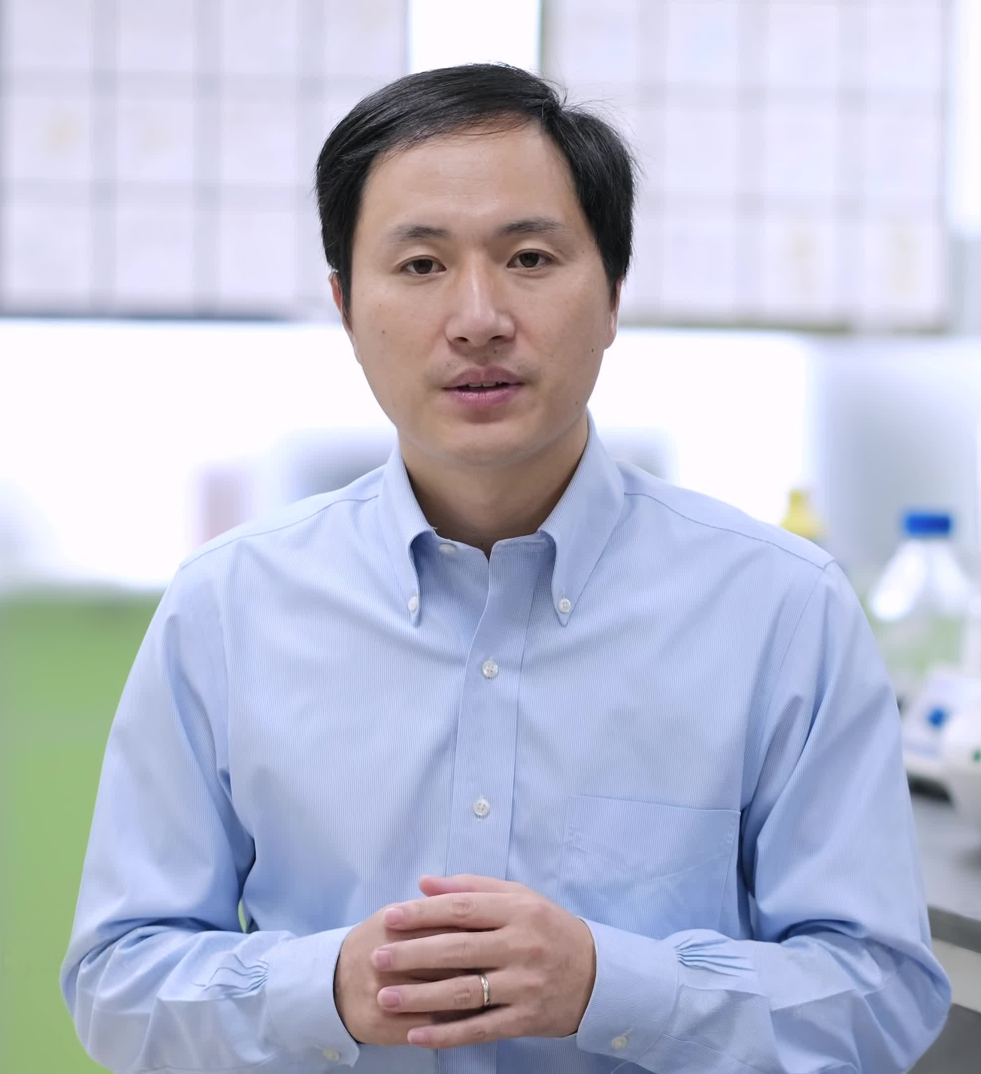 Photo of He Jiankui in a blue collard shirt who experimented to make CRISPR'd twins who were delivered last November.