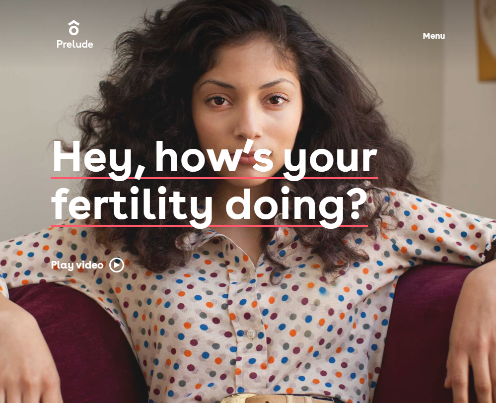 "A woman in a polka dot blouse lounging on a couch looks directly in the camera with the text ""Hey, how's your fertility doing?"" in bright font."