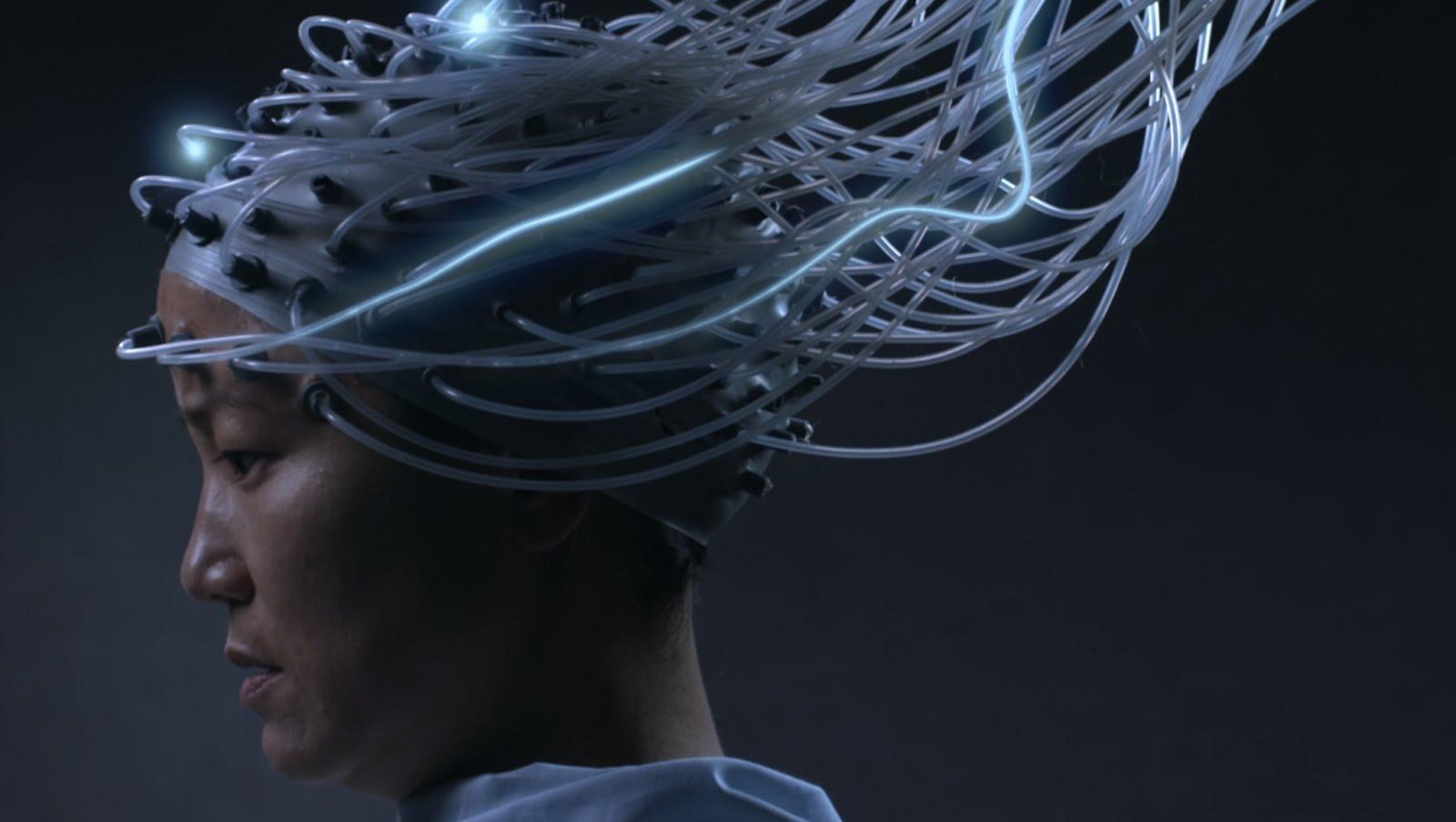 A still from the film Advantageous shows a woman with a sensory cap looks down (Youtube)
