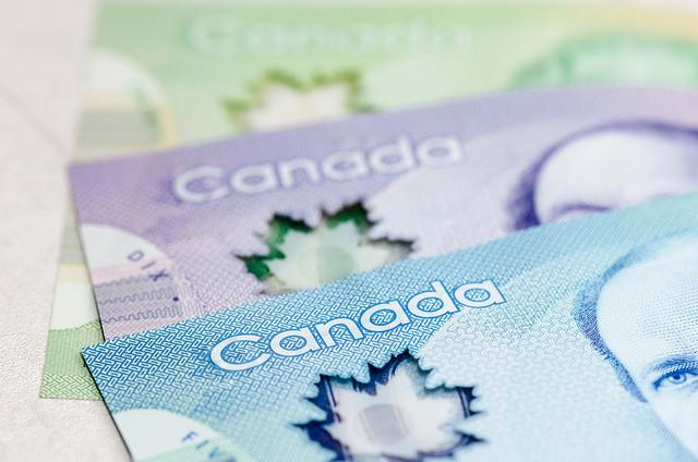 Close up of Canadian currency. Blue, purple, and green bills.
