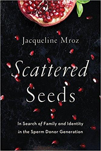 "The image is of the cover of Jacqueline Mroz's ""Scattered Seeds: In Search of Family and Identity in the Sperm Donor Generation,"" showcasing half of an open pomegranate at the top with pomegranate seeds scattered below against a black background."