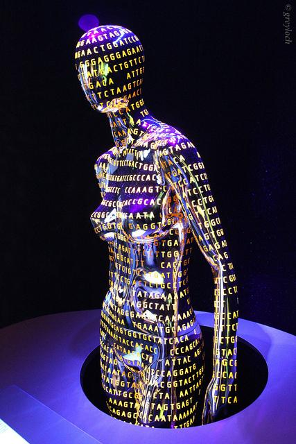 A mannequin of a human with DNA nucleotides (A, G, T, C) sequenced across it's body.