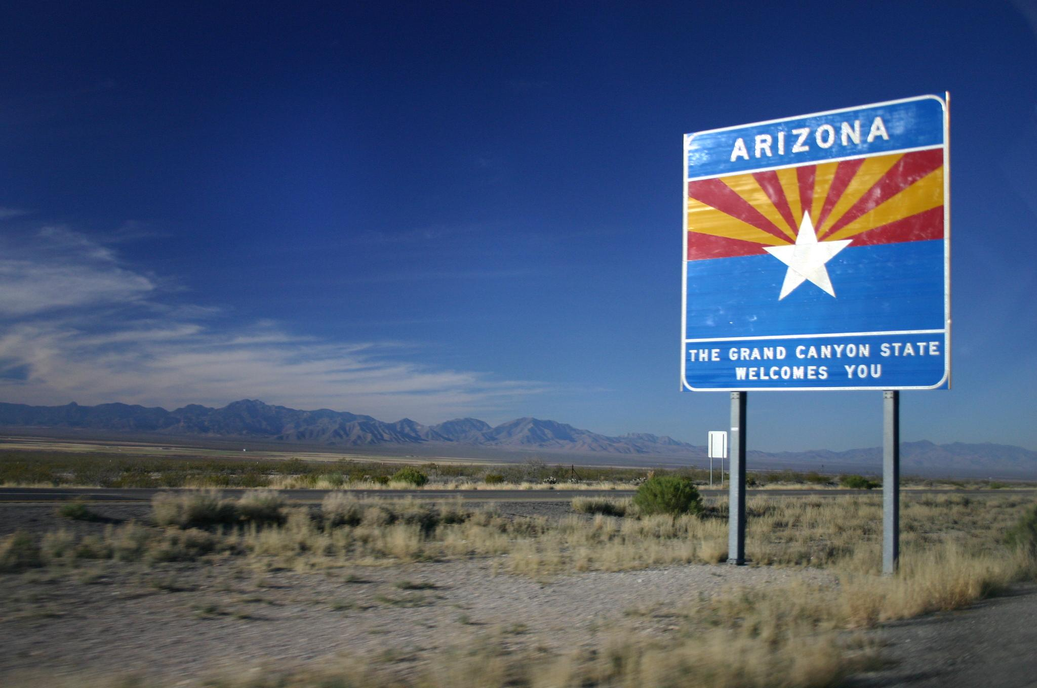"Sign says, ""Arizona: The Grand Canyon State welcomes you"""