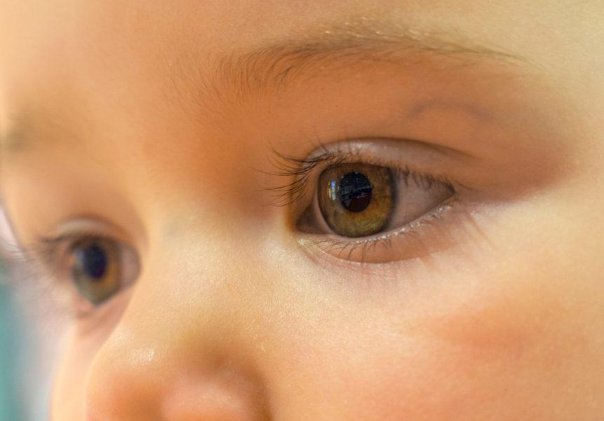 Close up of a baby's eyes staring into the distance.
