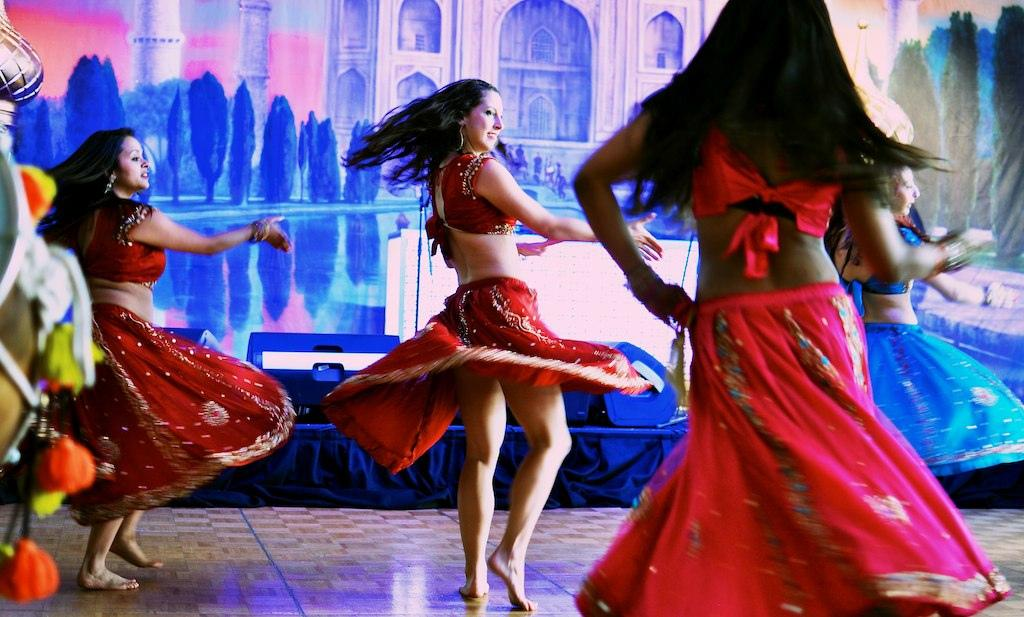 Three women dancing for Bollywood.