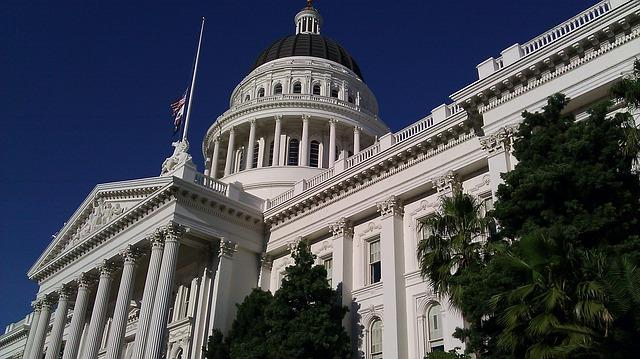 The dome and facade of the California state capitol building taken from a sharp upward angle