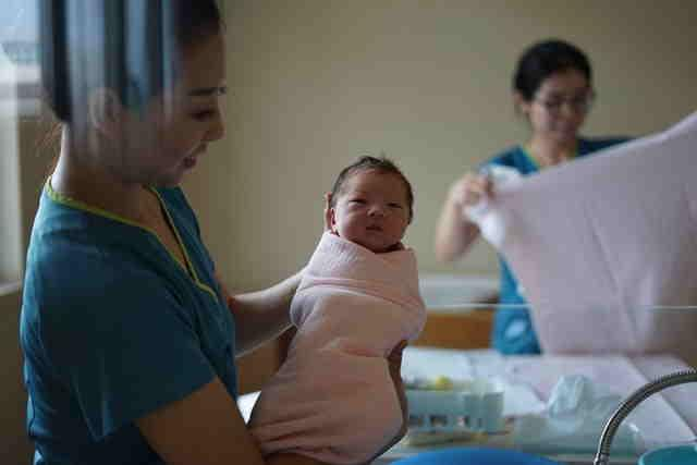 Chinese baby with nurse