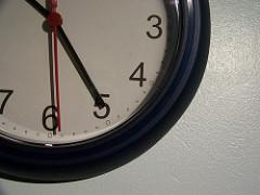 A clock appears hanging on wall, with its hands showing the time 10:25