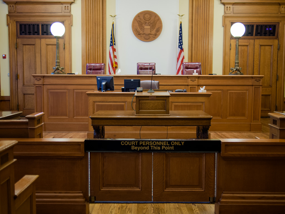An image of an empty courtroom in the United States.
