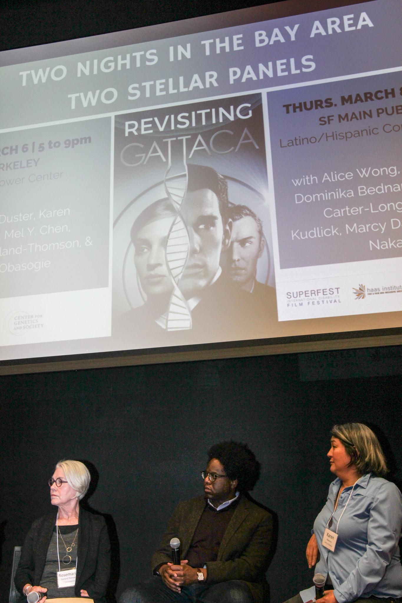 "Panelists Rosemarie Garland-Thomson, Osagie Obasogie, and Karen Nakamura sit under a projected image that reads ""TWO NIGHTS IN THE BAY AREA. TWO STELLAR PANELS."" Below, the words ""Revisiting GATTACA"" are superimposed on the Gattaca movie poster, featuring the faces of Uma Thurman, Ethan Hawke, and Jude Law."
