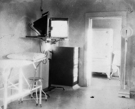 Black and white photo of an old hospital room.
