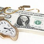 A bent golden pocket watch rests on a stack of US dollar bills.