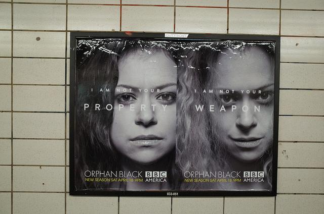 "An Orphan Black promotional poster, featuring two side by side portraits of a woman, with the headline ""I am not your property"" and ""I am not your weapon."""
