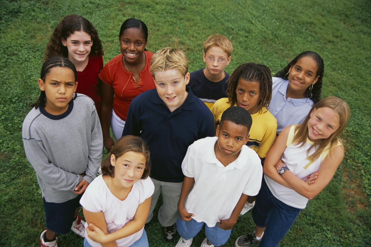 Diverse group of children standing in grass