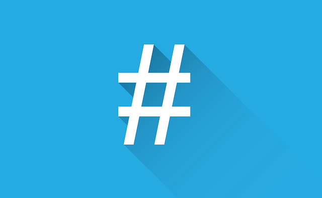 "A hasthtag icon, ""#,"" is in bold white font, against a light blue background in replication of Twitter."
