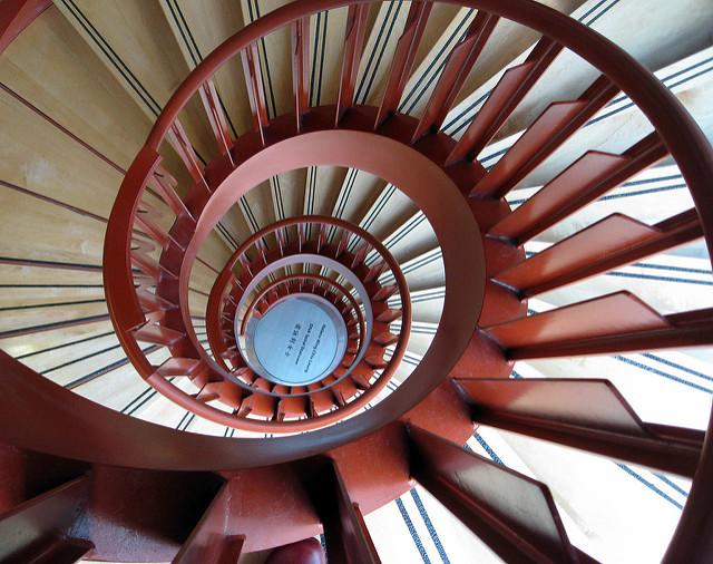A bird's eye view of a spiraling staircase cascading downward.