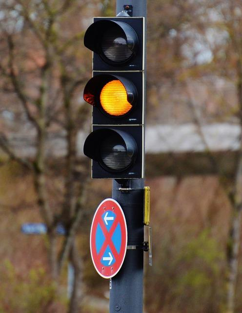 A traffic light appears yellow to signify caution (rather than a green go, and a red stop)