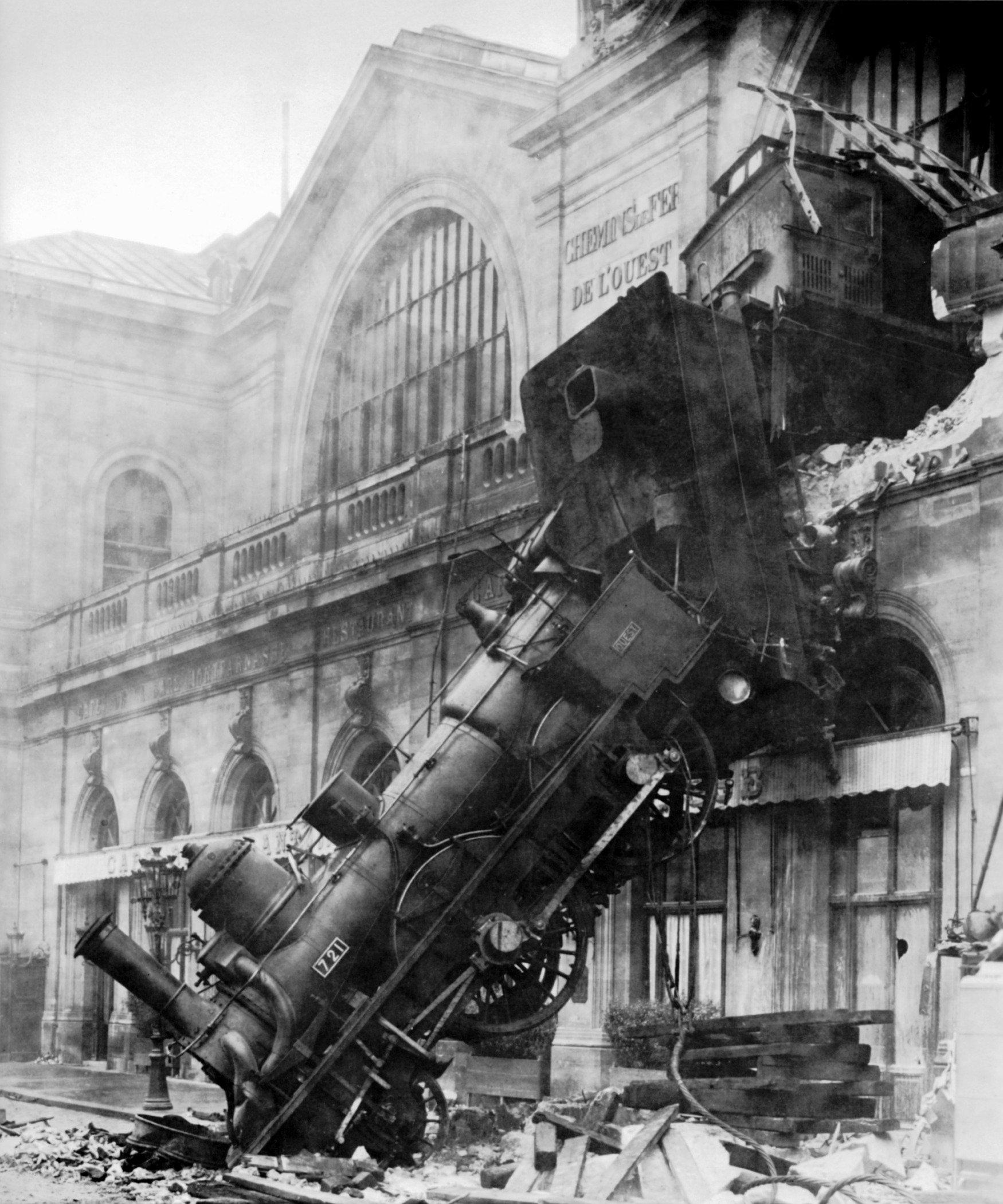 Black and white image of a runaway train that crashed into a building in Montparnasse