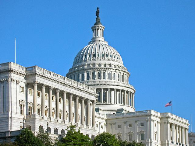 Image of the front of the US Capitol building taken from a diagonal angle.
